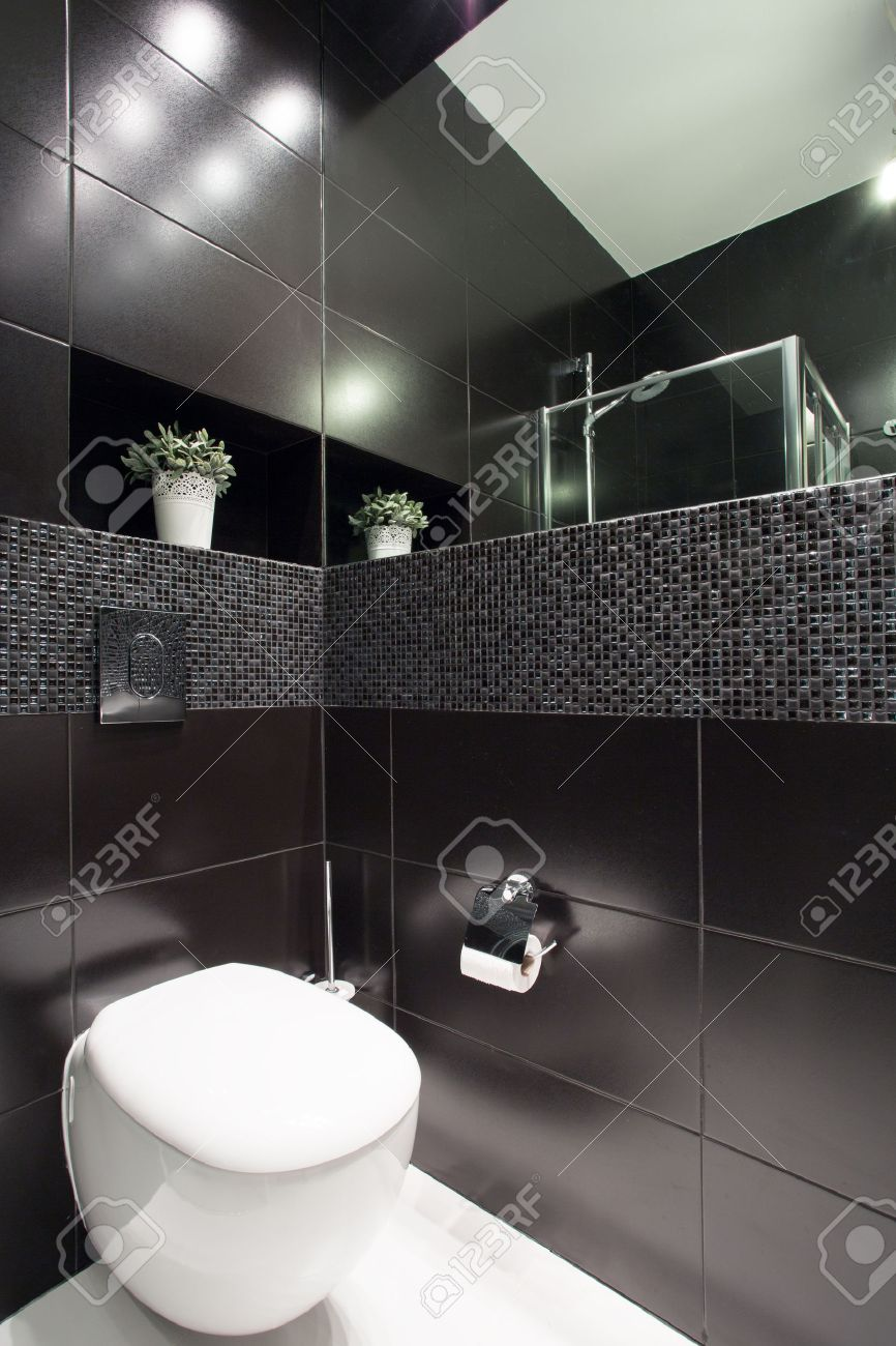 Stock photo white toilet in modern black restroom