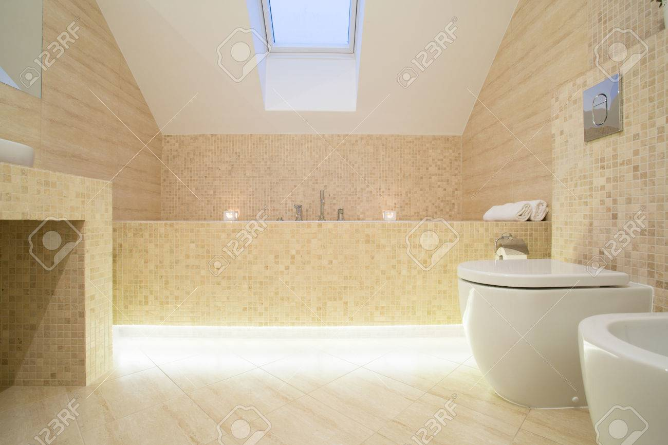 Warm Sophisticated Bathroom With Marble Floor Stock Photo Picture