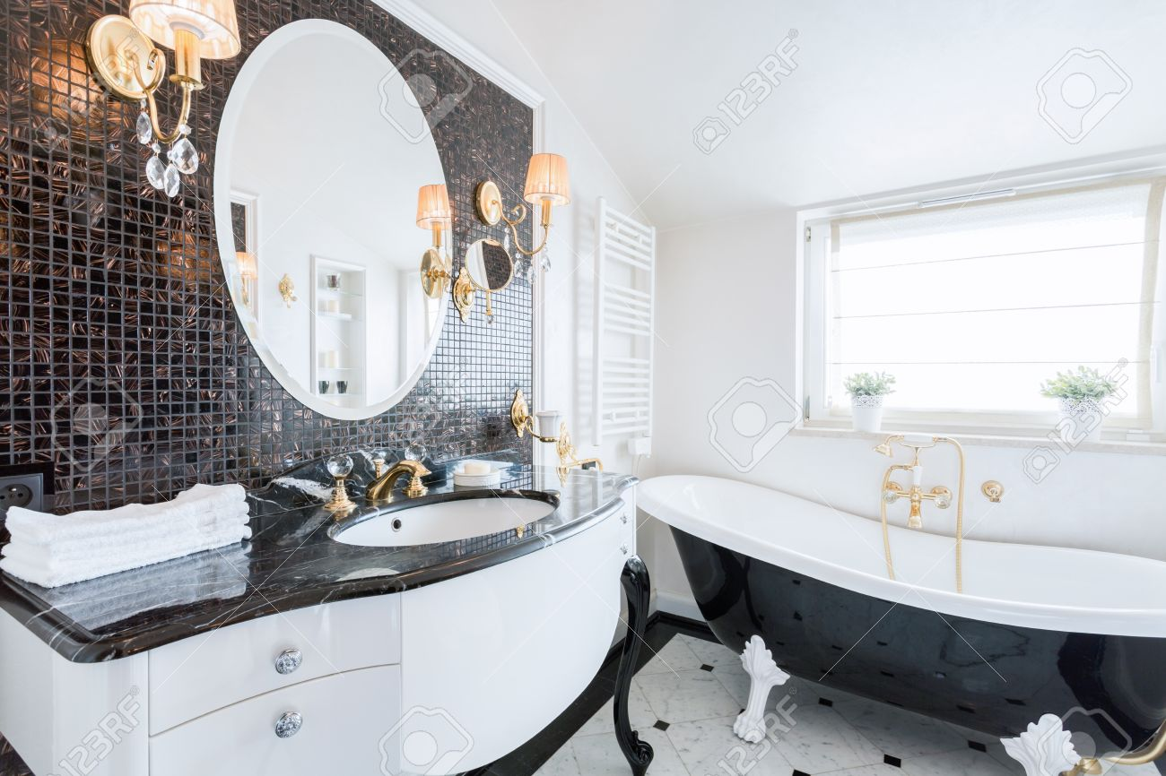 Stylish Washroom With Big Black And White Bathtub Stock Photo ...