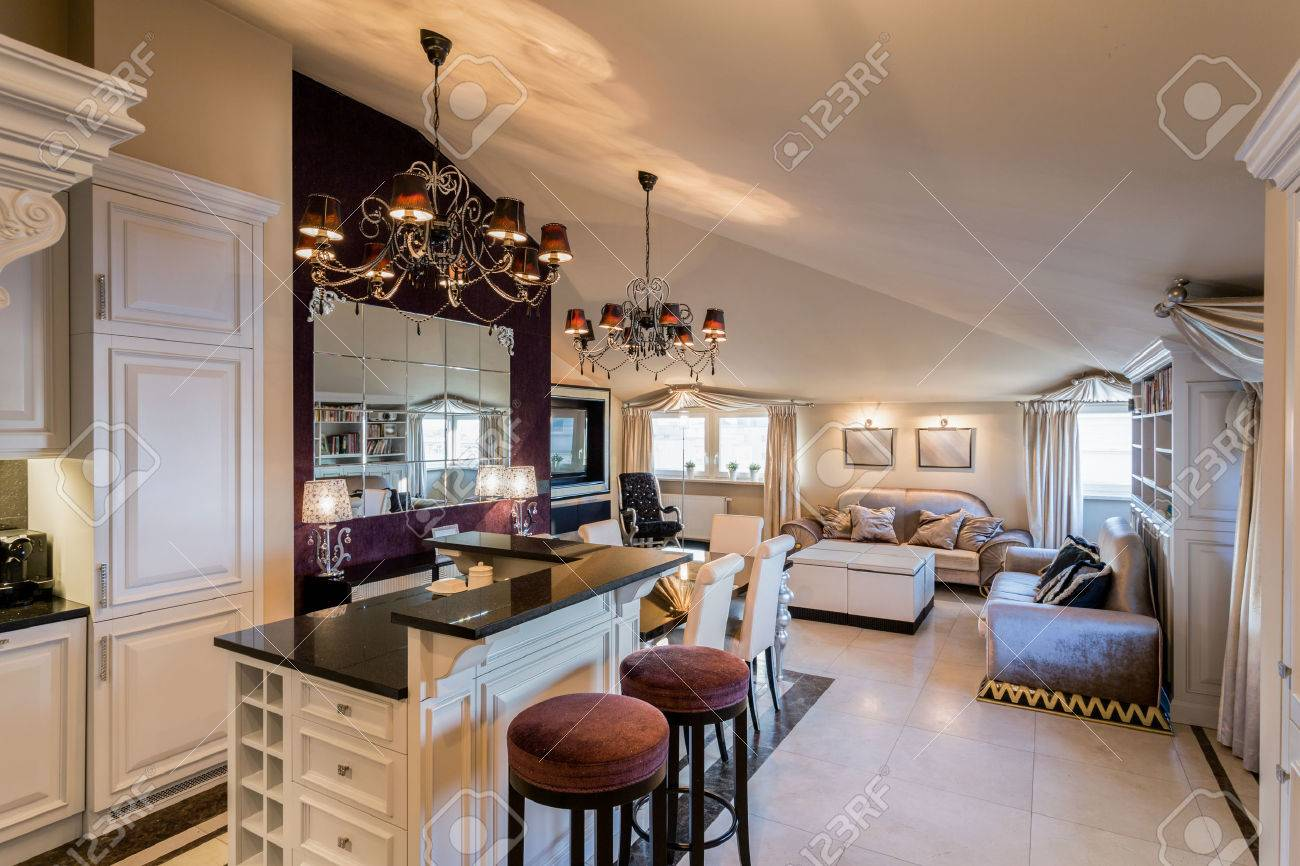 luxury kitchen with island connected with spacious living room