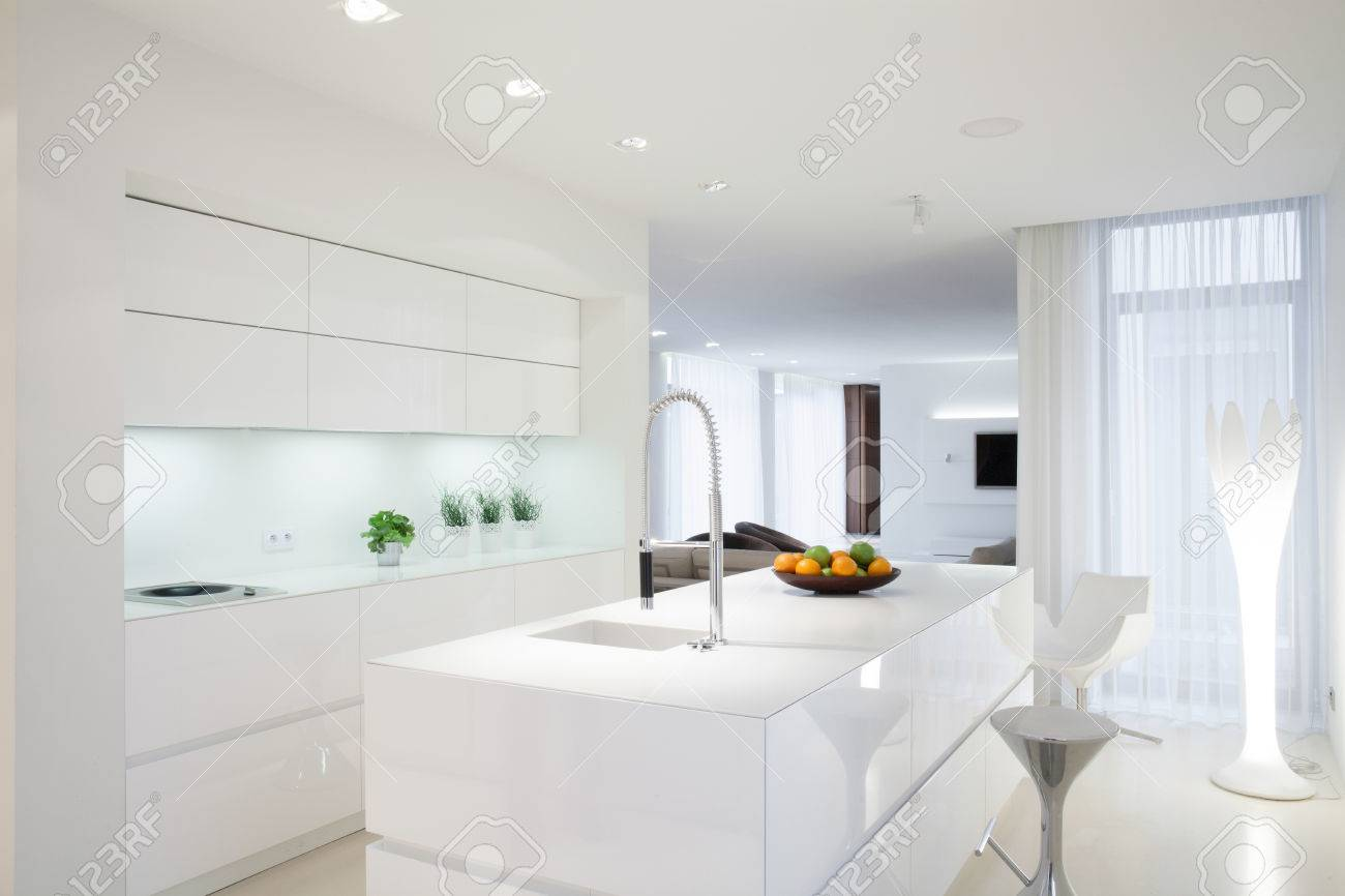 White Clean Kitchen With Island In The Middle Stock Photo Picture