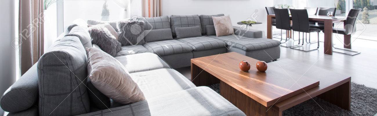 big comfortable couch and stylish wooden coffee table stock photo 4034282632 couch