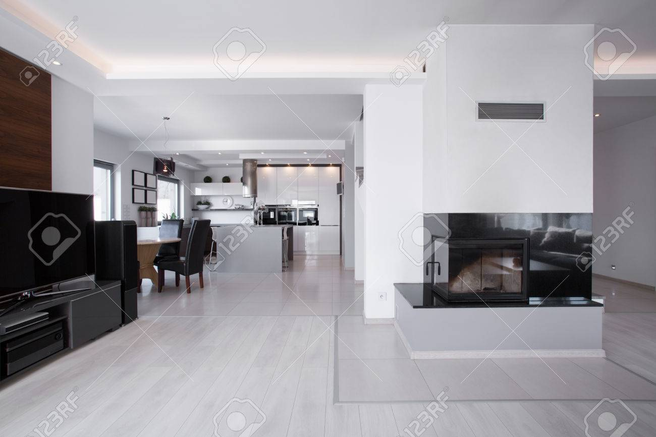 Big Bright Space In Room With Fireplace And Home Cinema Stock Photo ...