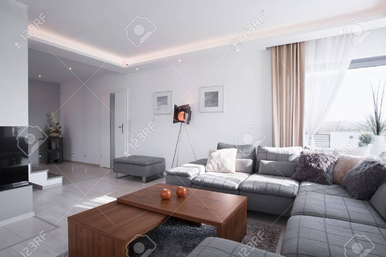 Contemporary Design Of Spacious Living Room With Big Sofa Stock ...