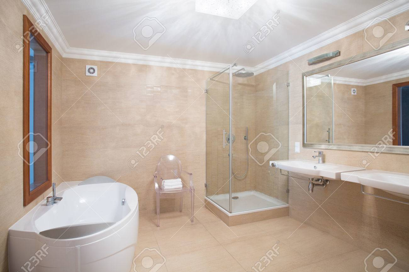 Elegant Spacious Bathroom Interior In Beige Colors Stock Photo   41444383
