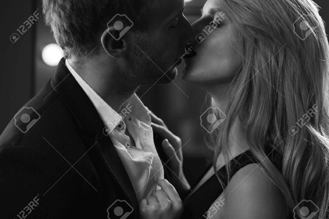 Portrait Of Man And Woman In Love Kissing Passionately Stock Photo Picture And Royalty Free Image Image 41795299