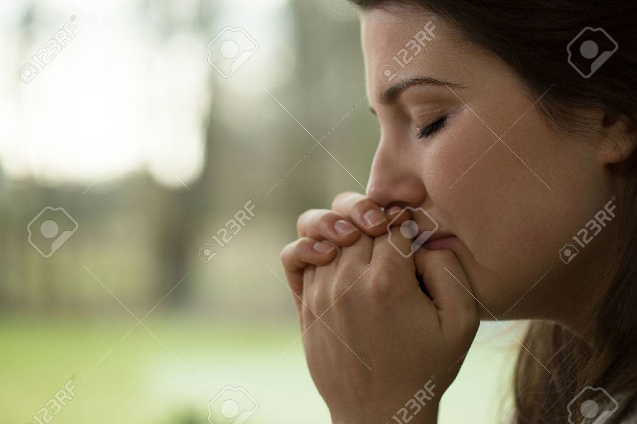 Horizontal view of depressed young woman crying - 41852185