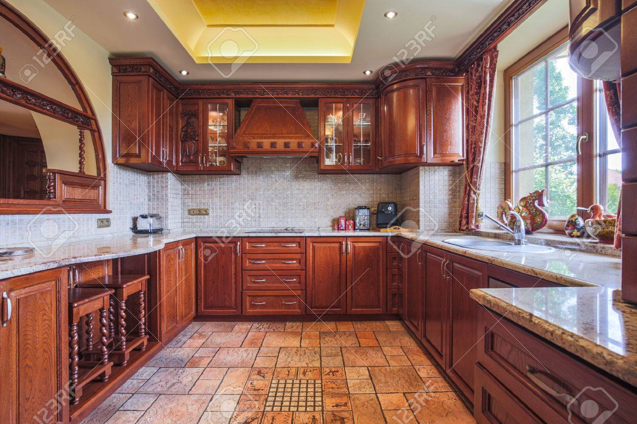 Stock photo wooden kitchen unit in colonial style interior