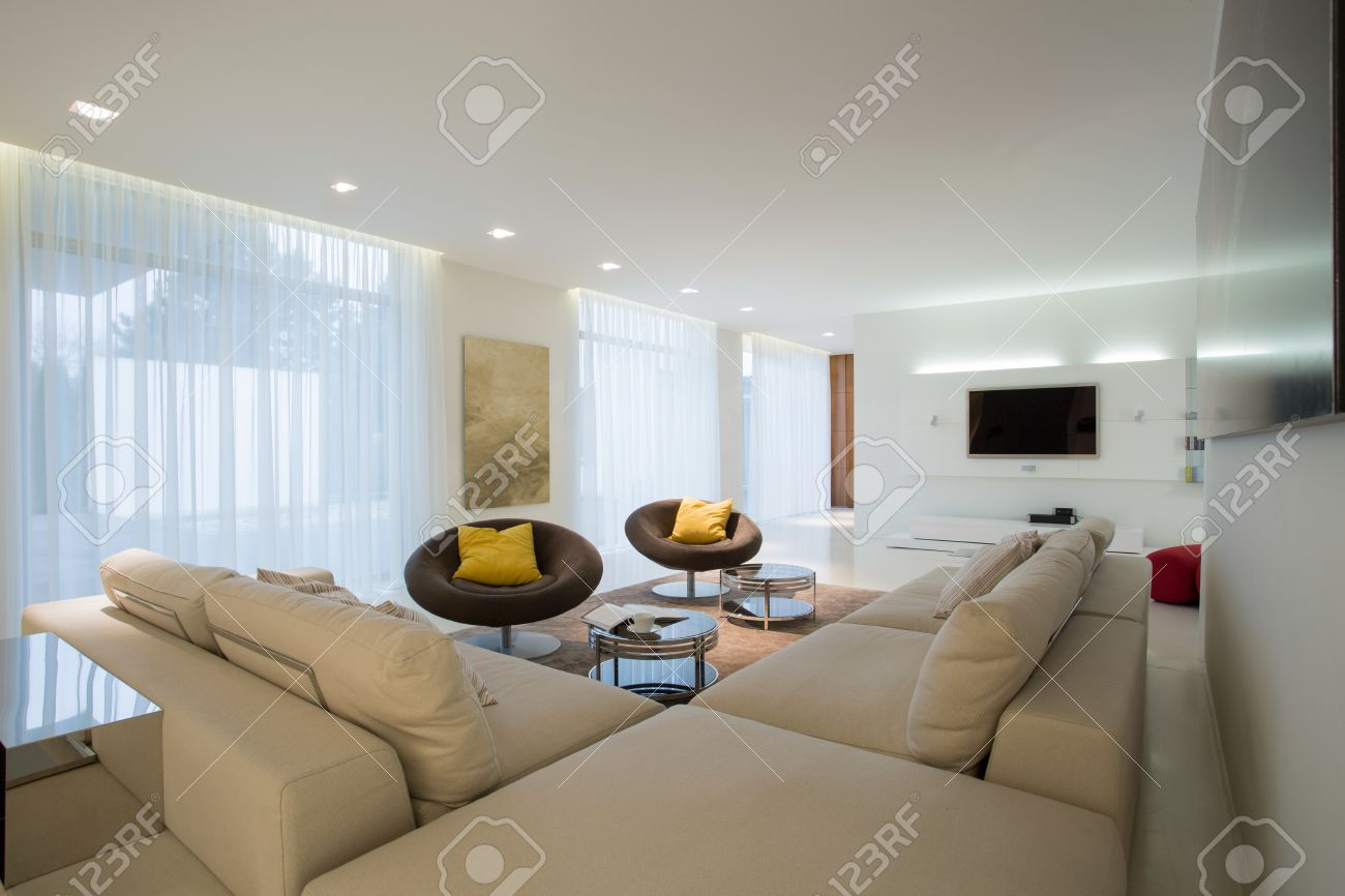 Comfortable Corner Sofa In Contemporary Drawing Room Stock Photo
