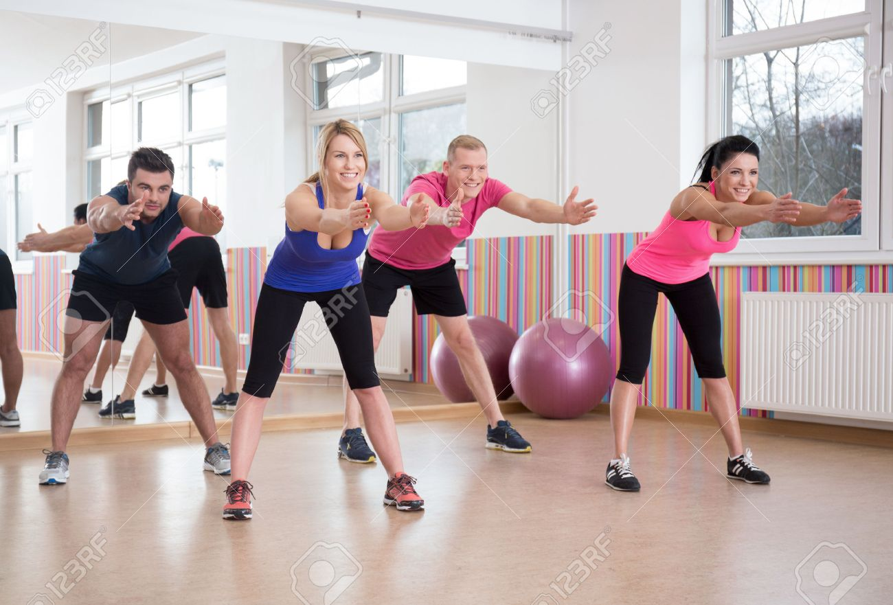 Group Of People Exercising In Pilates Room Stock Photo, Picture And ...