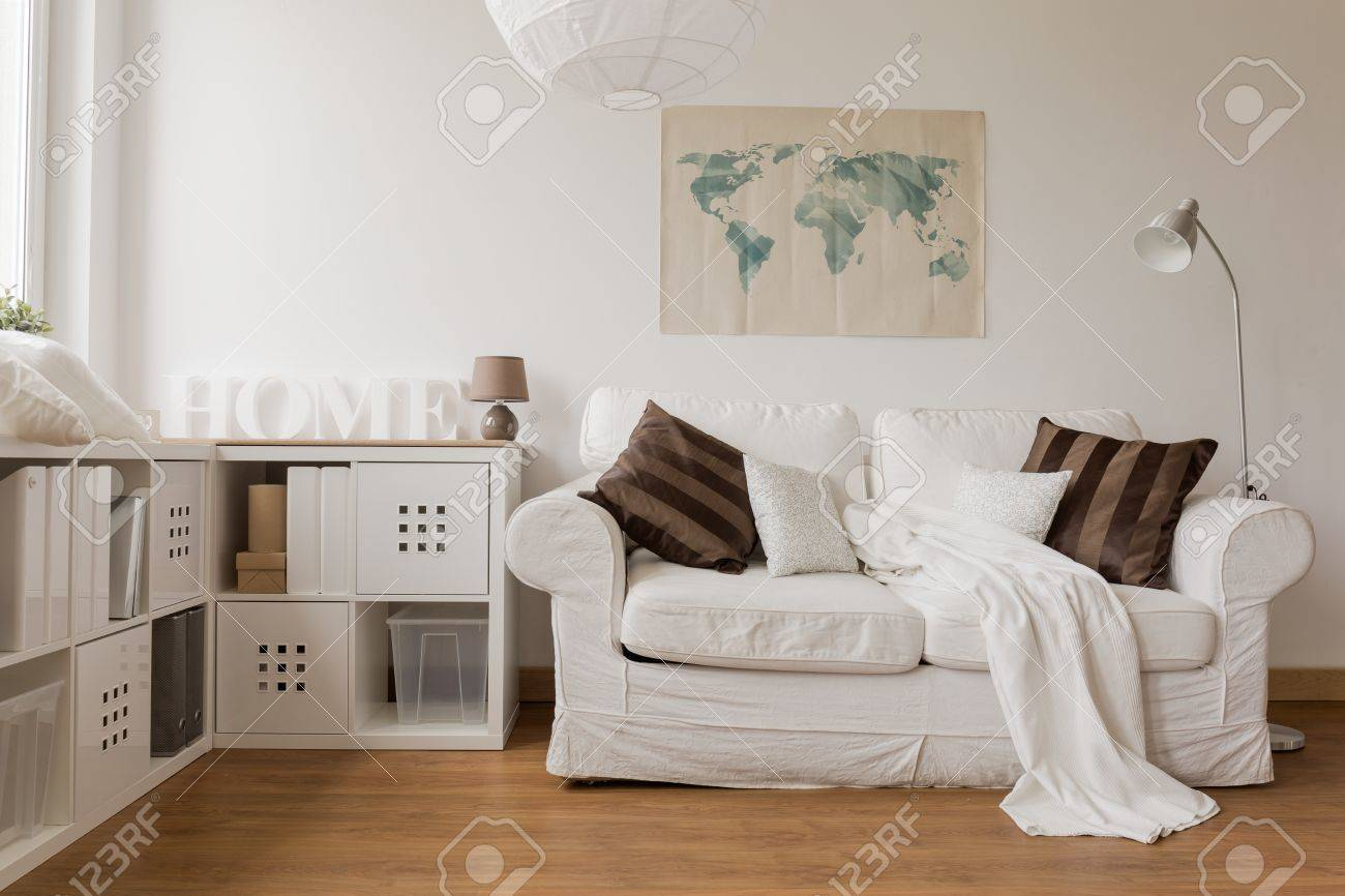 White Sofa And Commode In Cozy Living Room Stock Photo, Picture And ...