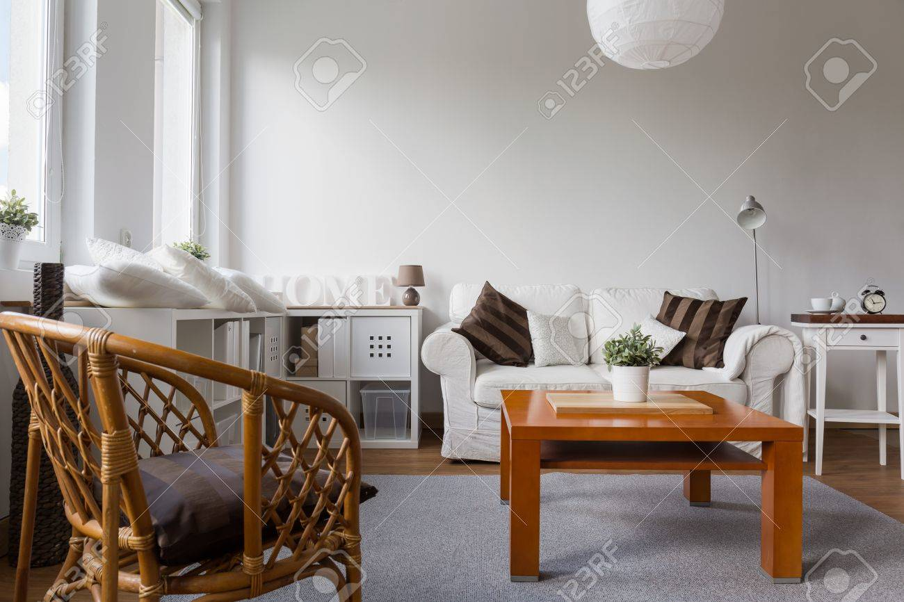 Wicker armchair in white stylish living room