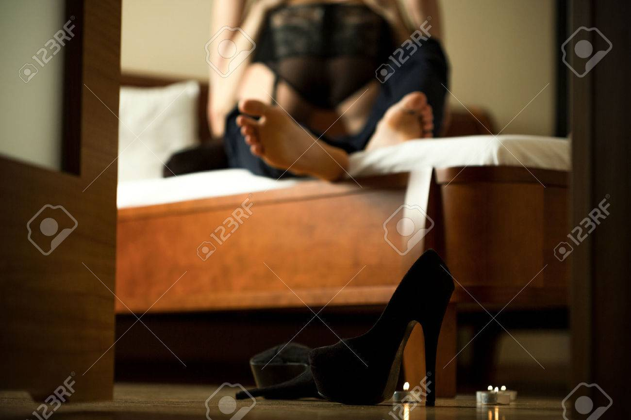 Passionate couple making love in hotel room - 42429365