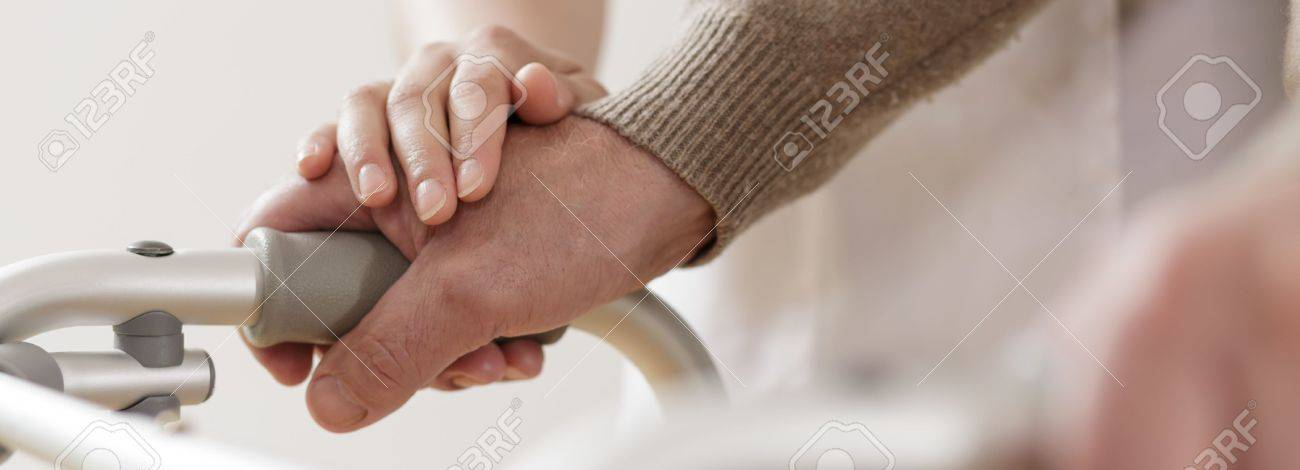Close-up of disabled man walking with assistance Stock Photo - 43070486