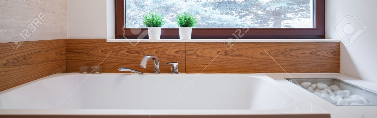 Panorama Of Big Bathtub With Ceramic Wood Imitation Backsplash Stock ...