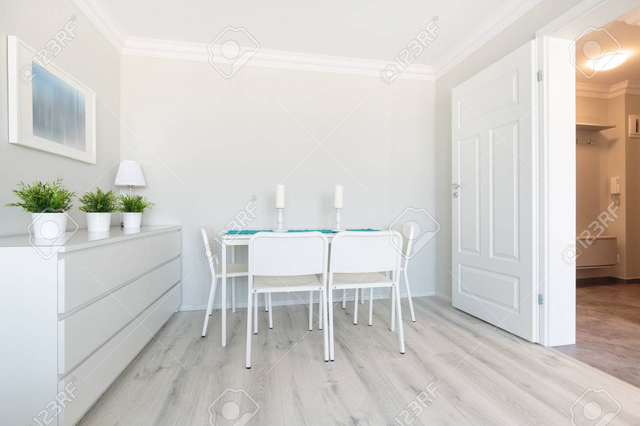 Picture Of New Design Dining Area With White Wooden Furniture Stock