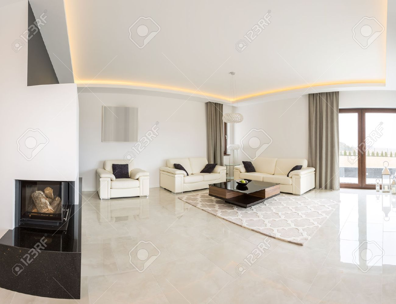 Spacious Bright Living Room With Fireplace And Marble Floor Stock ...
