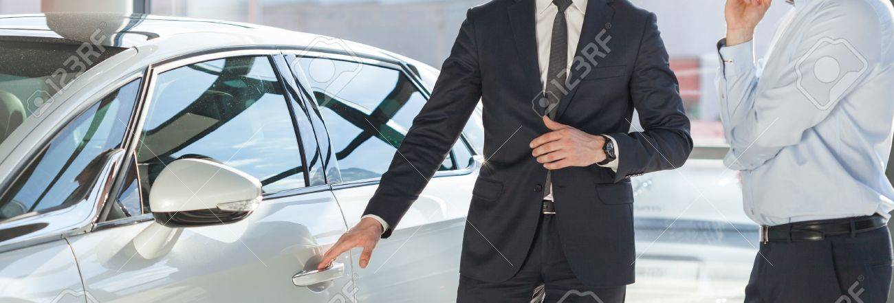 Young man in suit standing by his modern luxurious car Stock Photo - 43692230
