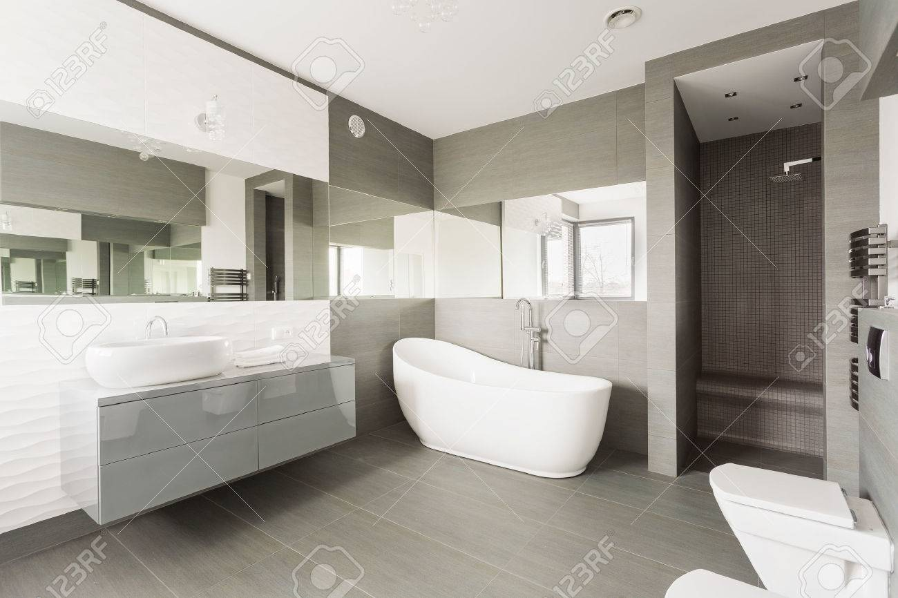 White And Grey Exclusive Big Washroom With Fancy Bath Stock Photo ...