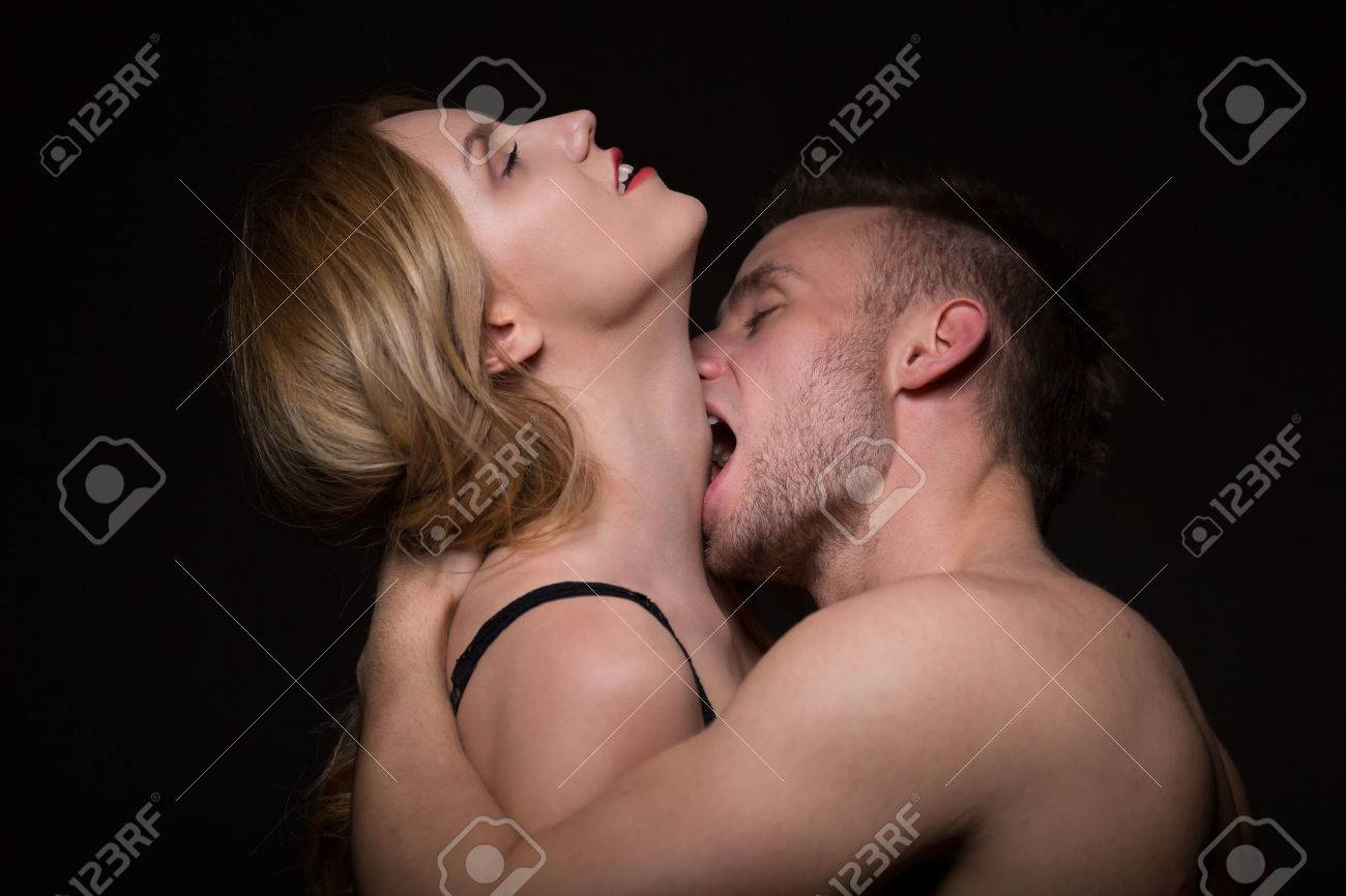 Man Passionately Kissing And Biting A Woman In The Neck Stock Photo Picture And Royalty Free Image Image 44084596
