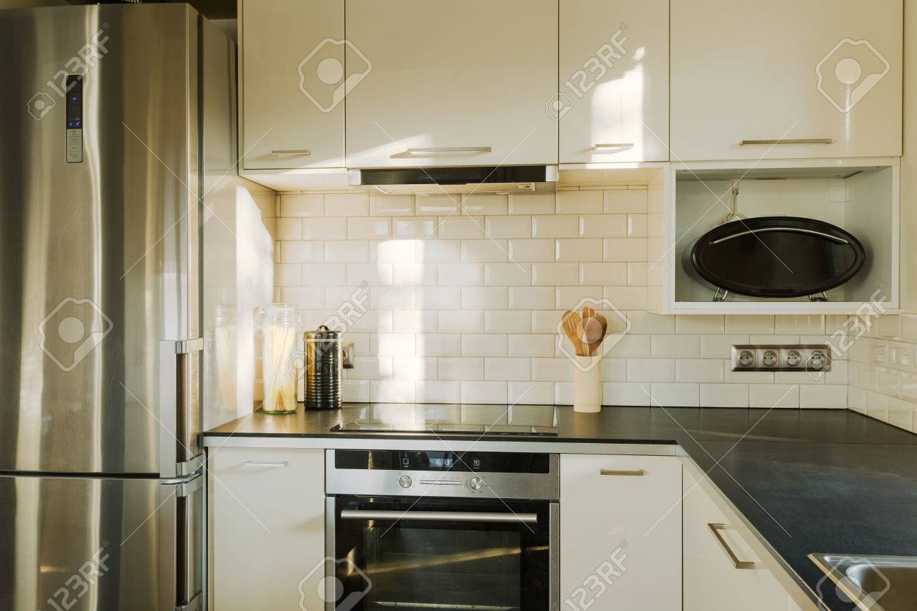 White Brick Wall In Contemporary Designed Kitchen Stock Photo ...