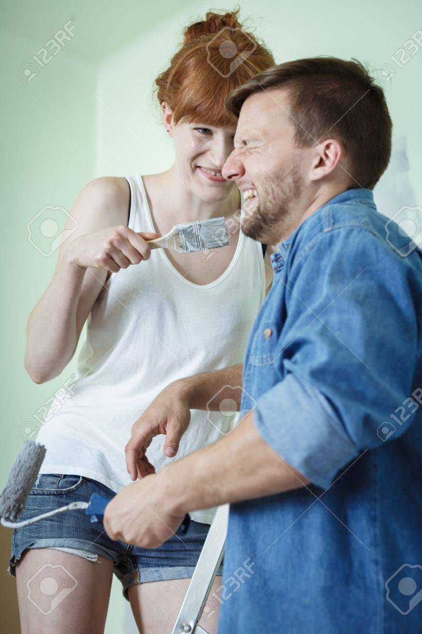 Happy Couple Redecorating House And Painting Walls Stock Photo 44784082