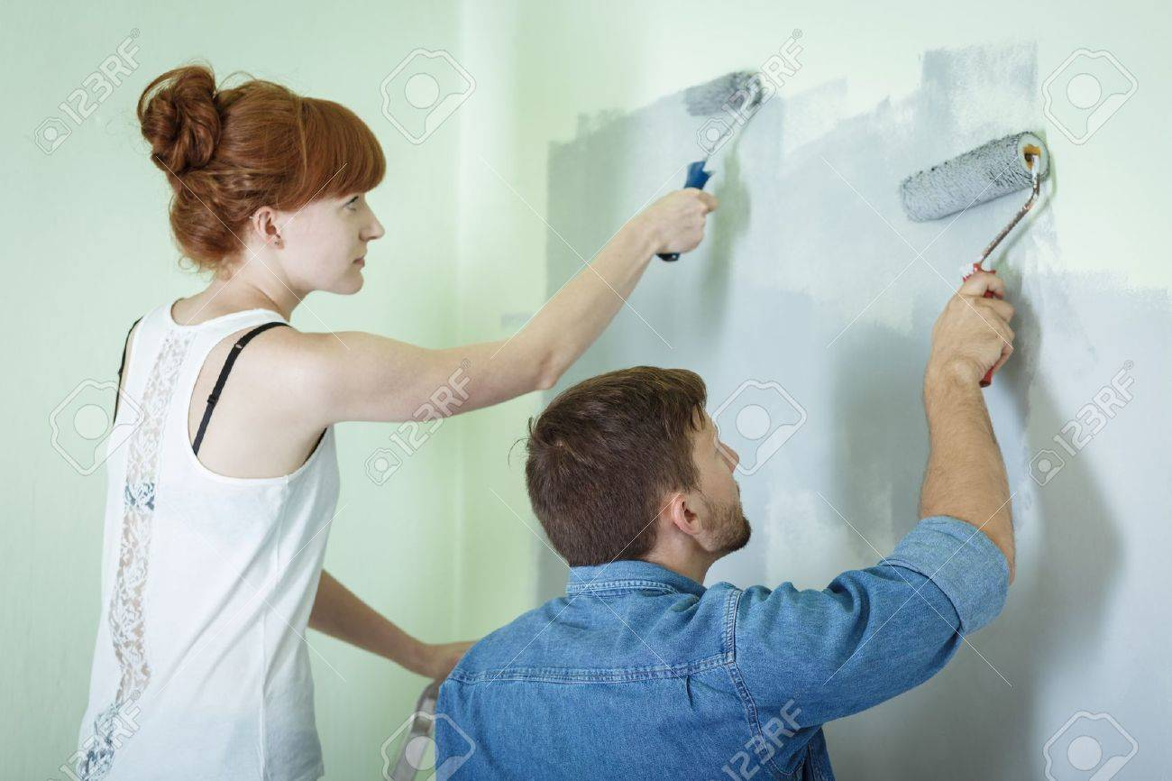 Couple Redecorating House And Painting Wall Together Stock Photo   44838882