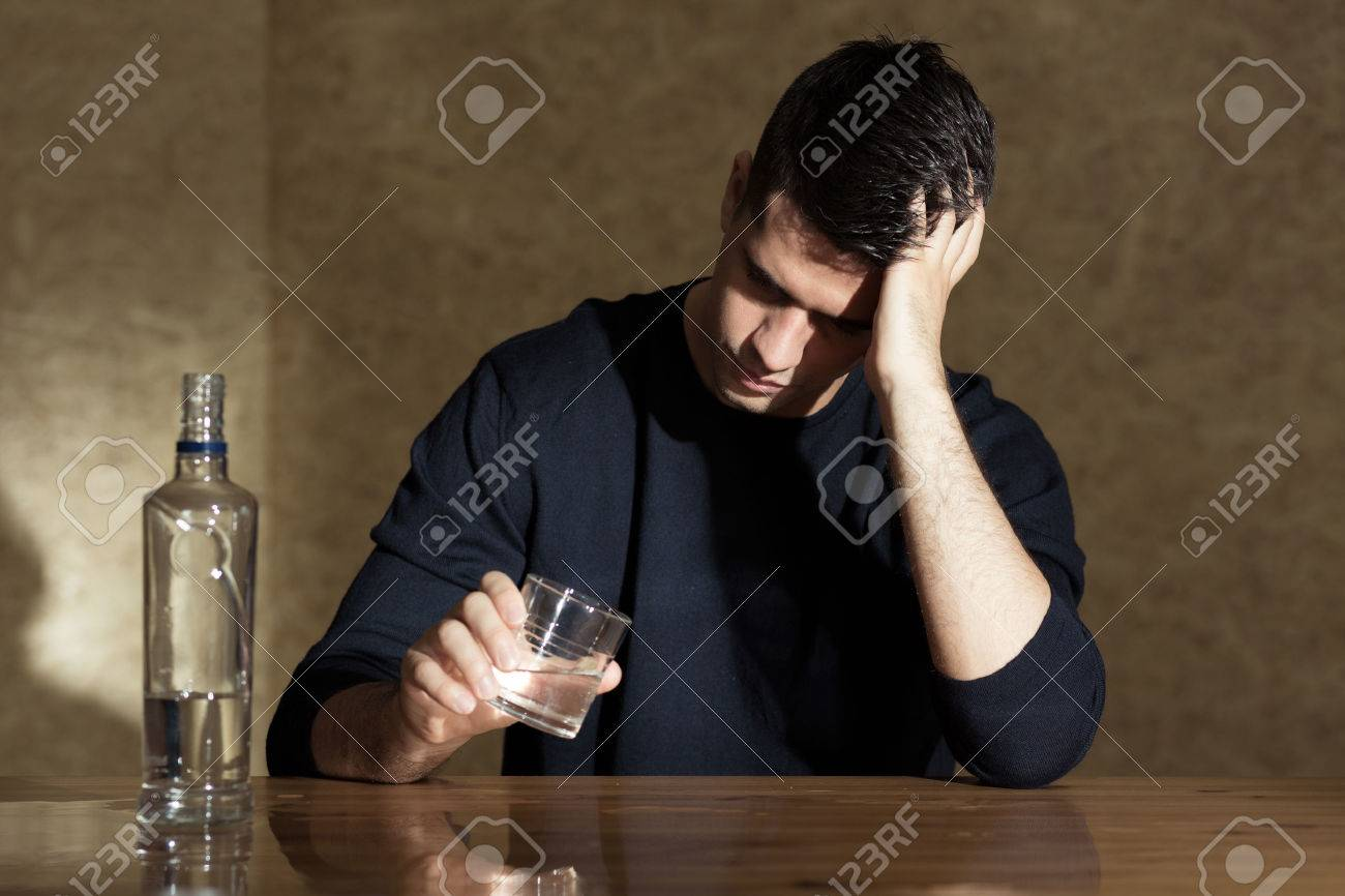 aba7ad65a961 Young Man Drinking Vodka In The Glass Stock Photo, Picture And ...