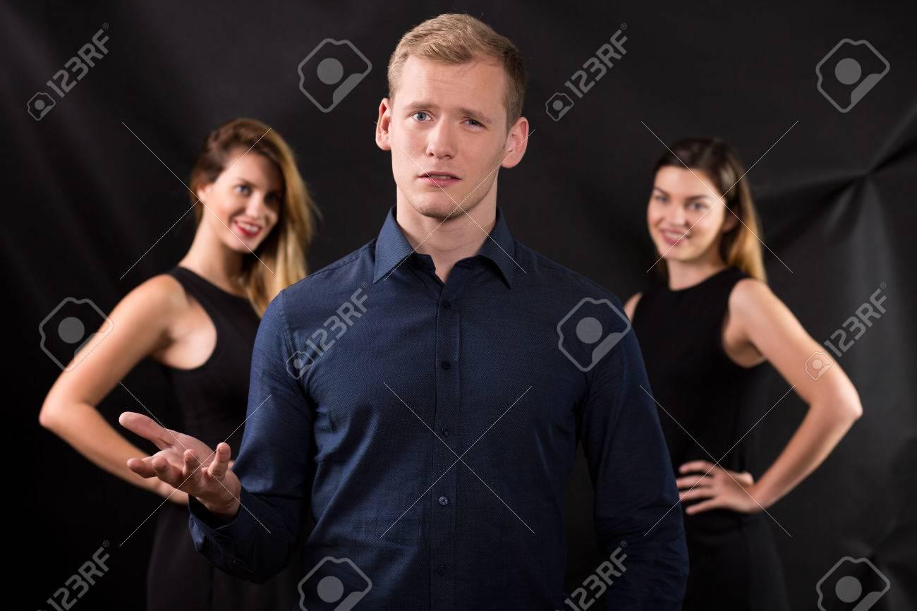 Two women seduce man