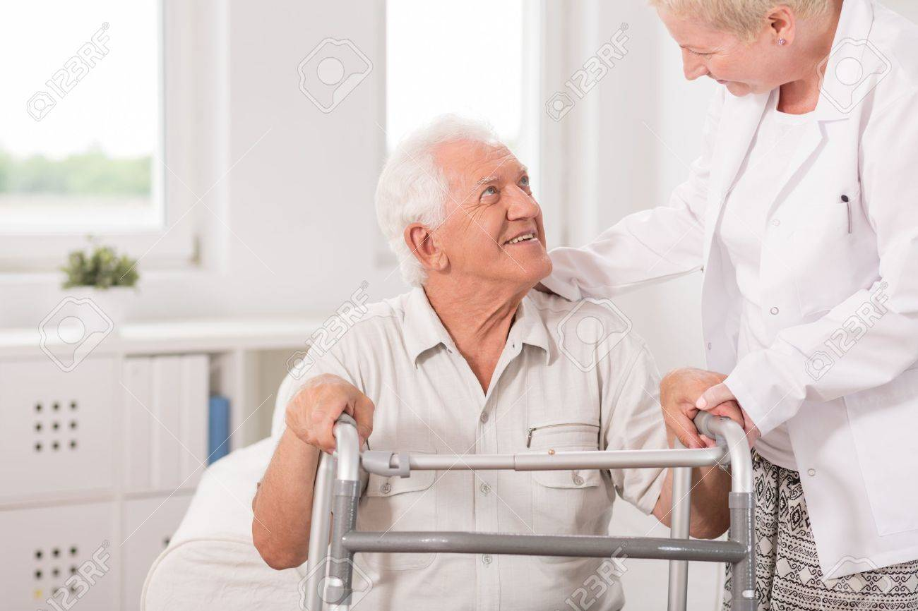 Old Man Is Using Zimmer Frame For Walking Stock Photo, Picture And ...