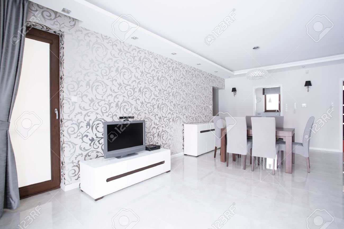 Contemporary Spacious White Living Room With Patterned Wallpaper ...