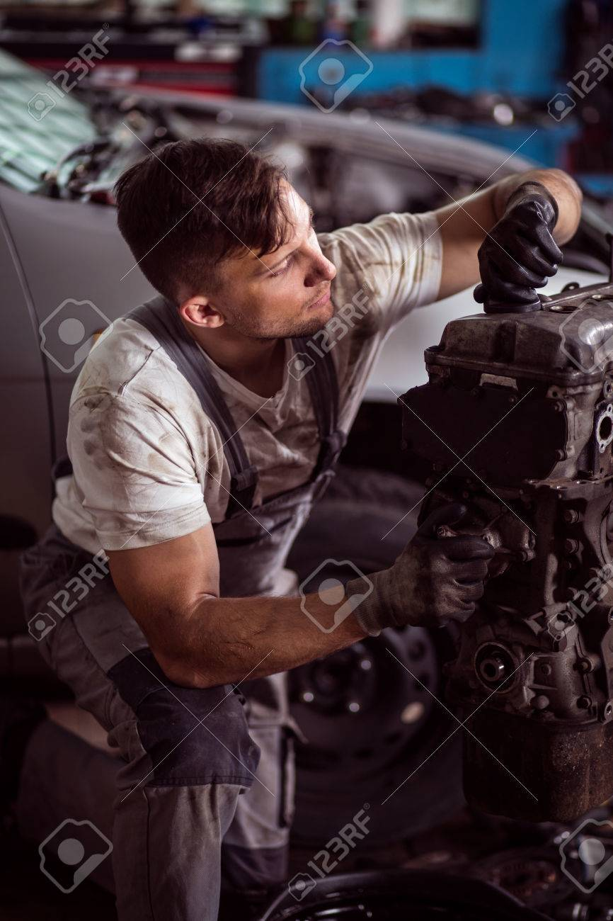 Mechanic Is Checking All Components Of Car Engine Stock Photo ...