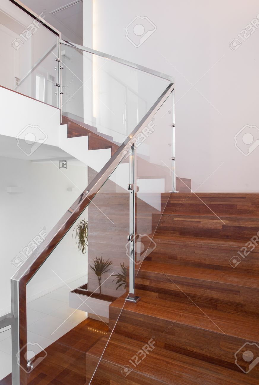 Modern Wooden Stairs With Metal Hand Rail Stock Photo   48765588