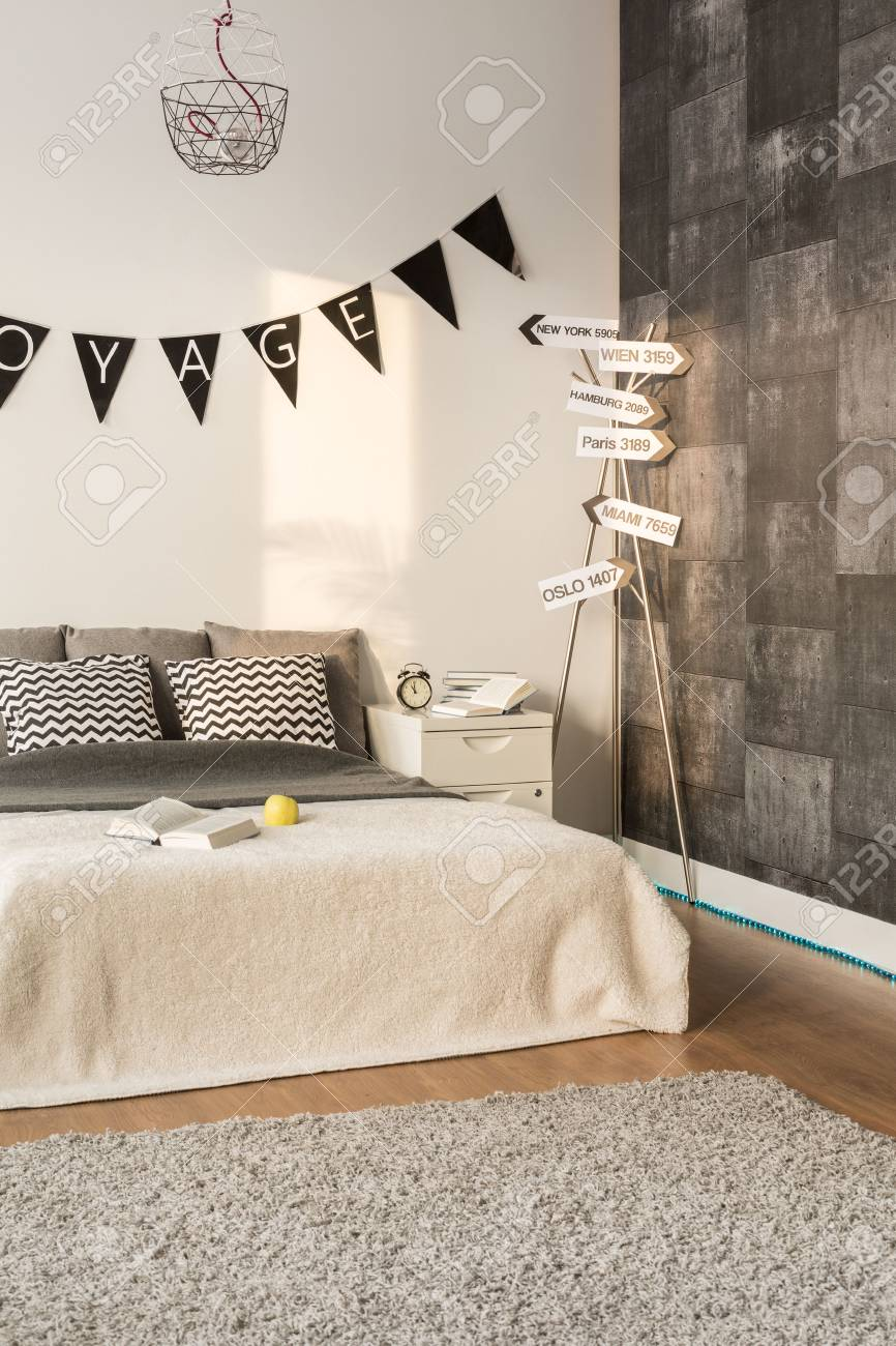 . Photo of spacious sleeping area with new decorative wallpaper