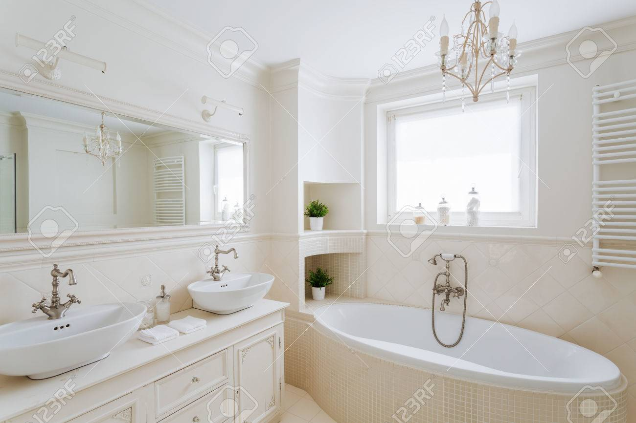 Horizontal Picture Of A Showy Bathroom Designed In Creamy Colors ...