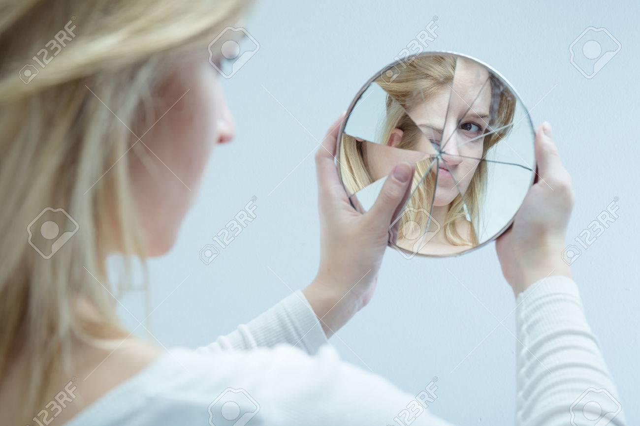 Unhappy pretty girl with complexes and broken mirror - 50351997