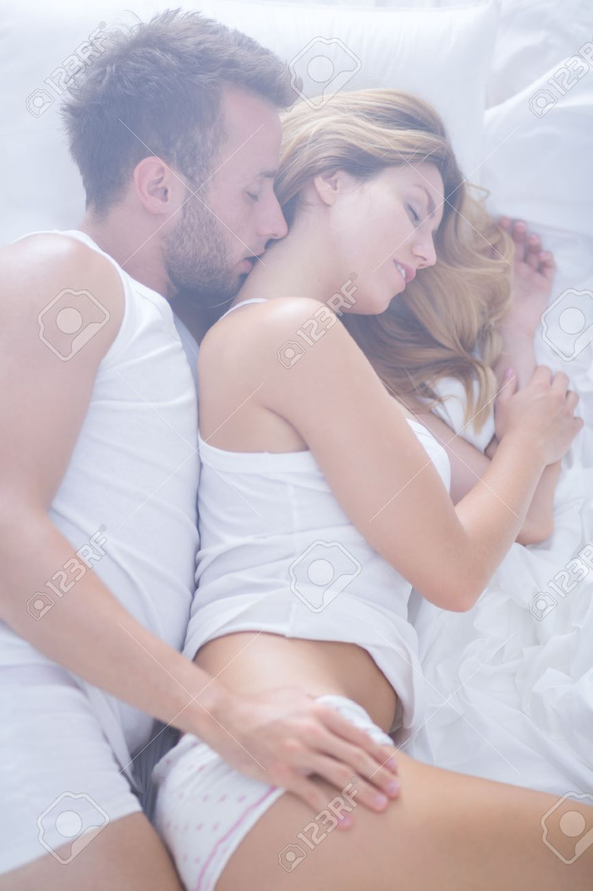 Image Of Romantic Couple Lovers Lying In Bed Stock Photo