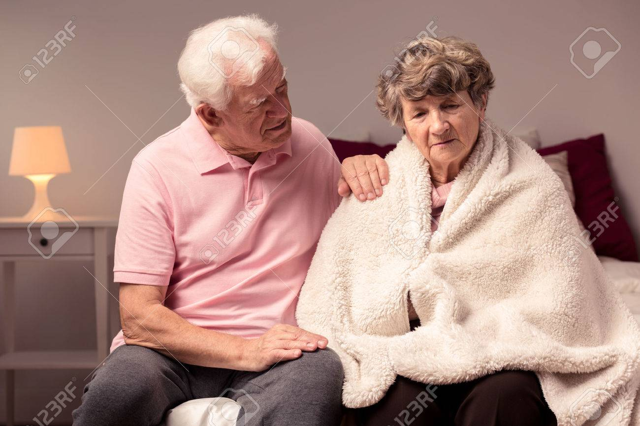 Image of man helping sad wife with health afflictions - 50098196