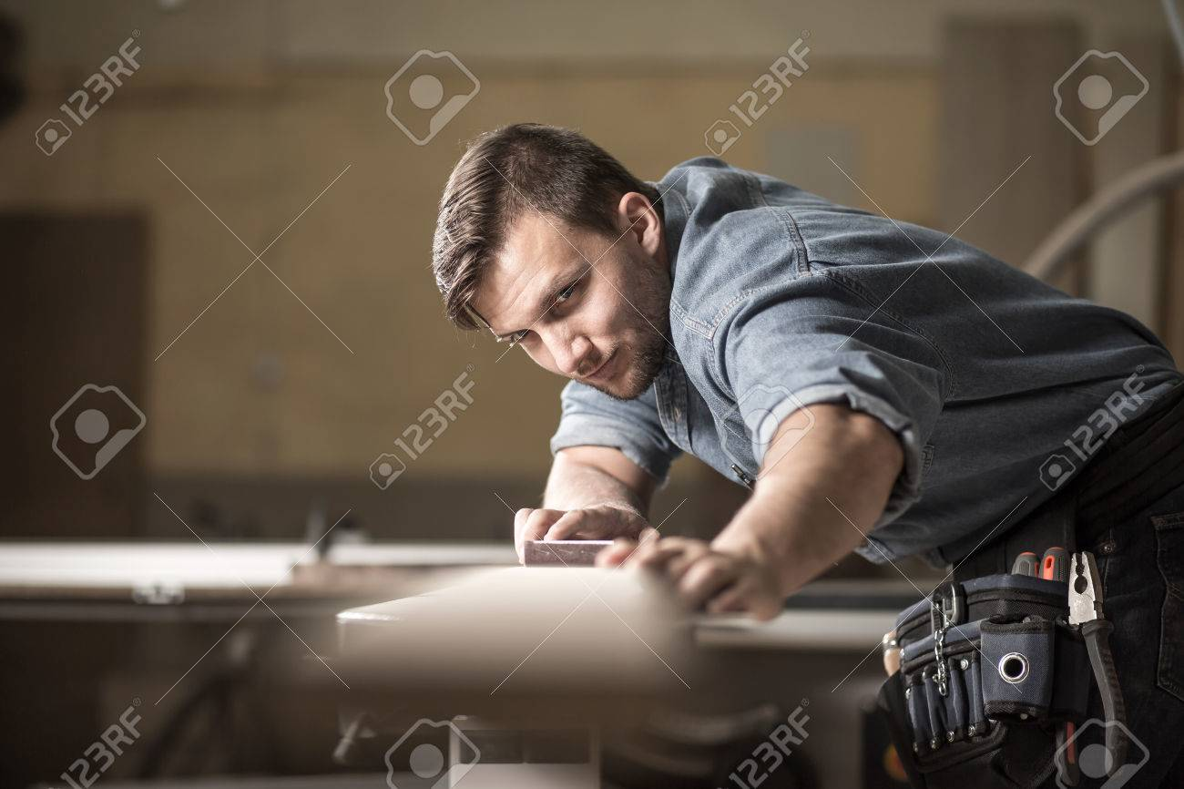 Photo of male wood expert checking quality of board - 51172416