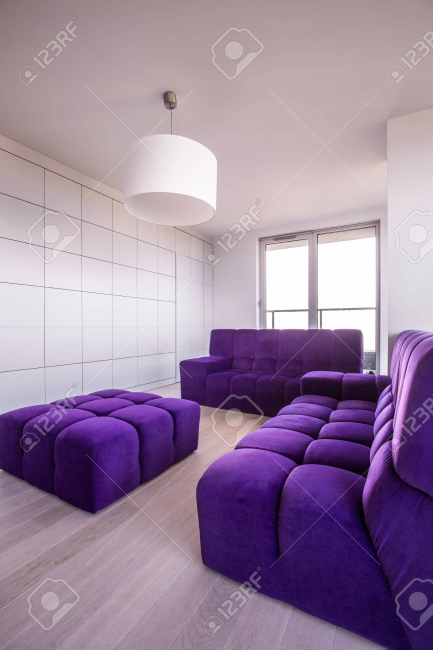 Purple and white living room in the flat