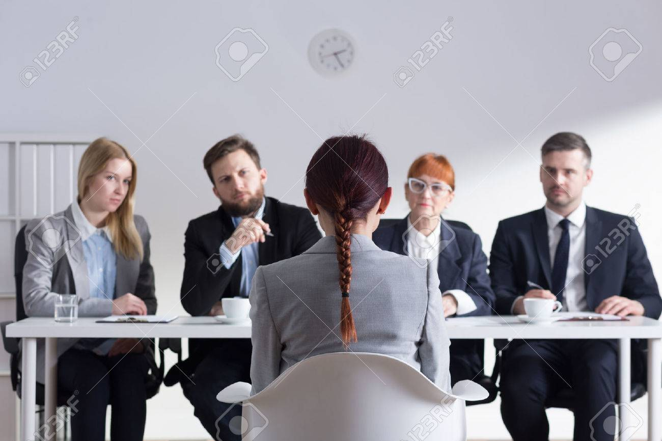 Woman during job interview and four elegant members of management - 51793960