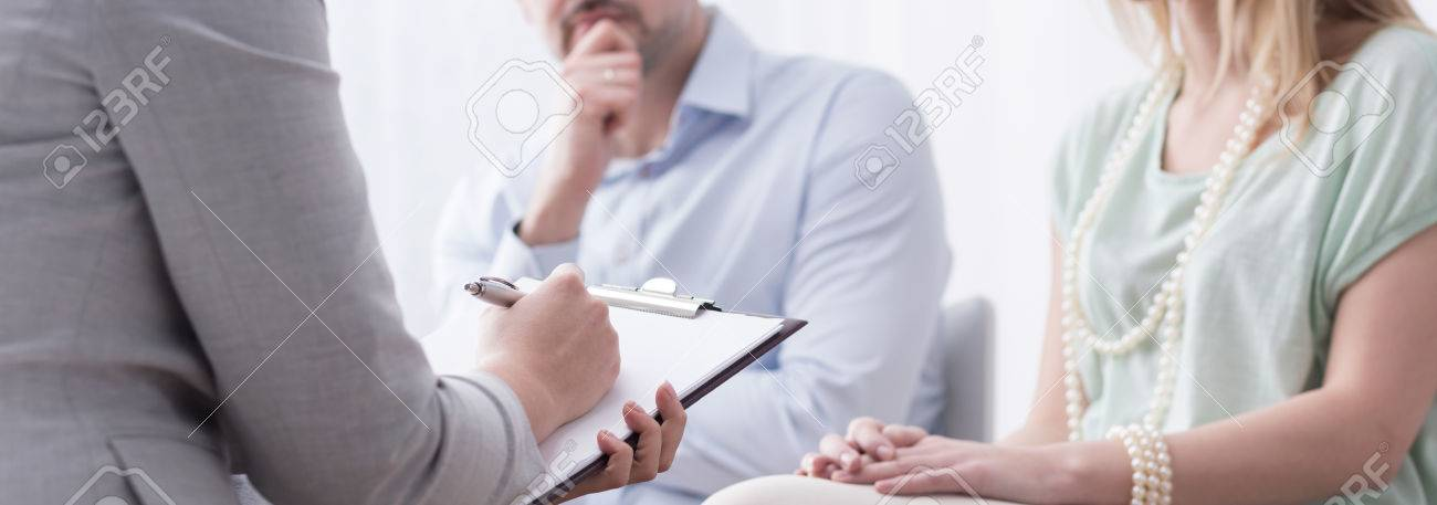 Panorama of psychologist helping married couple with problem - 52309020
