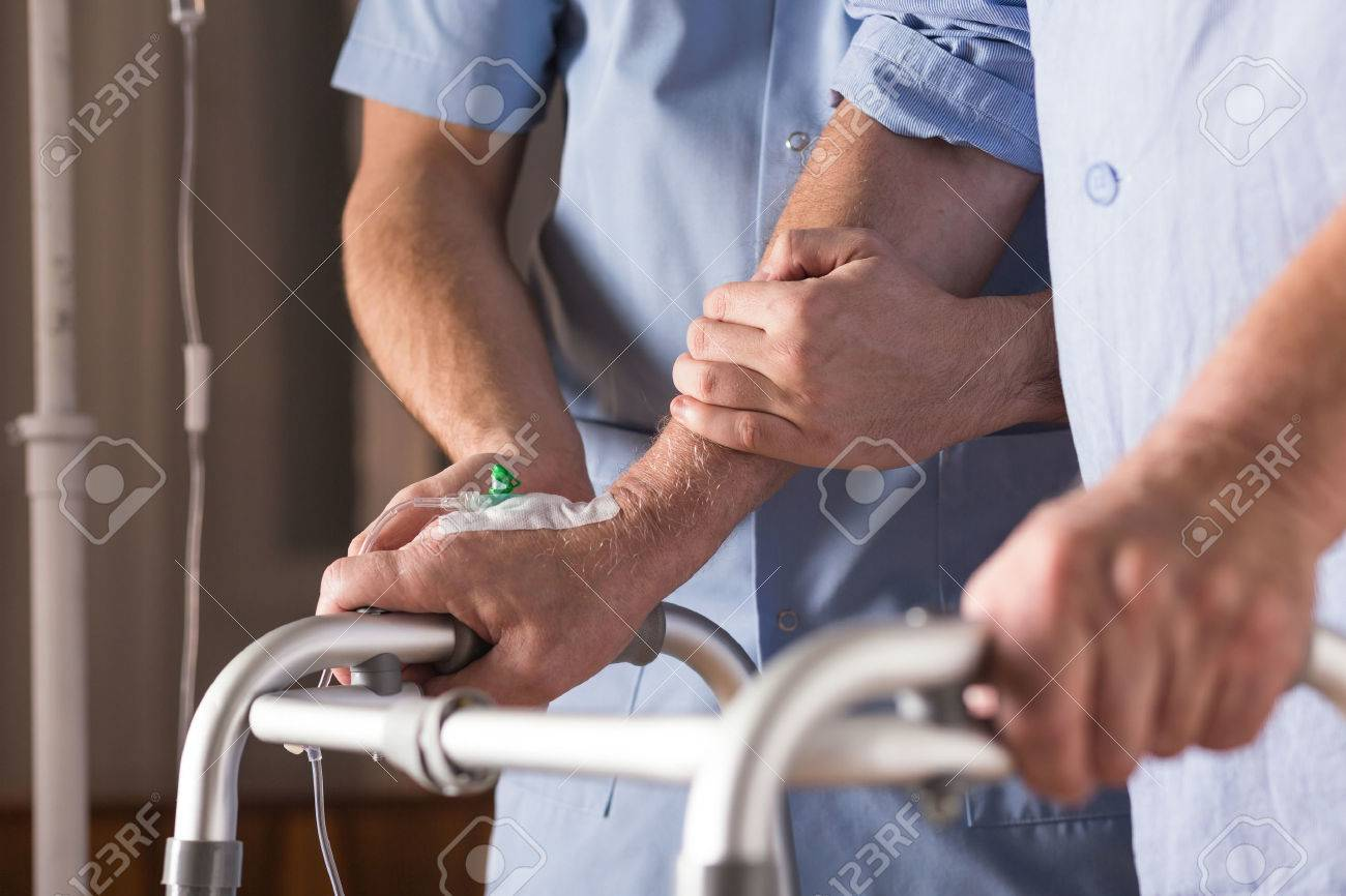 Close-up of disabled person walking with assistance Stock Photo - 51795642