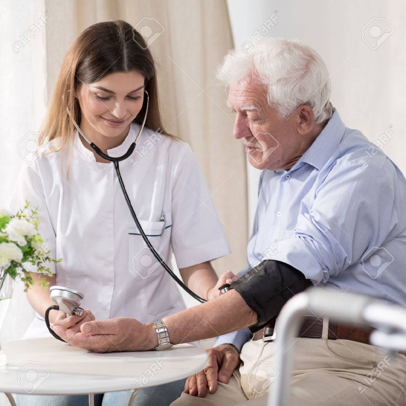 Young nurse is taking elder man's blood - 52250827