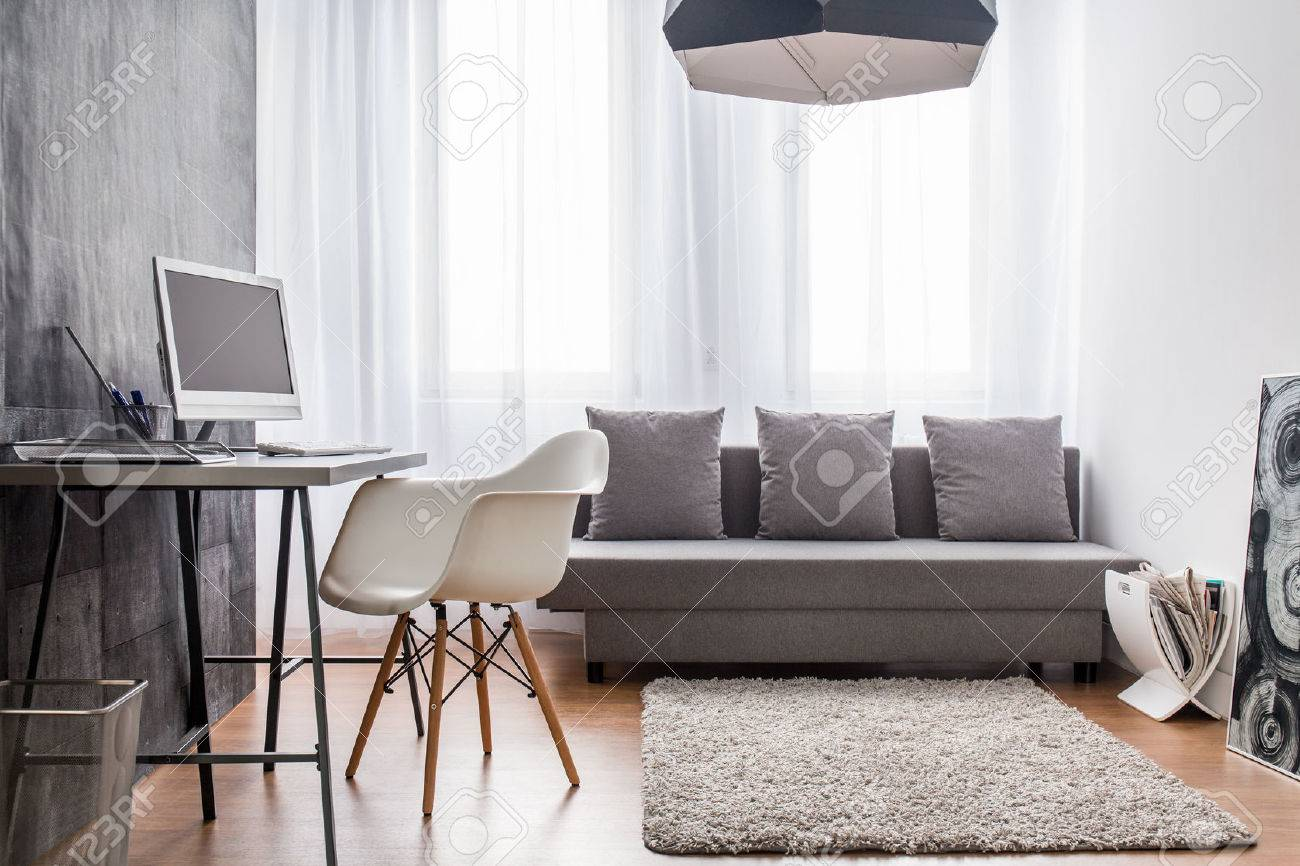 office living room. Office Room And Living Combined. Interior With Cement Wallpaper. Stock Photo - 52251154