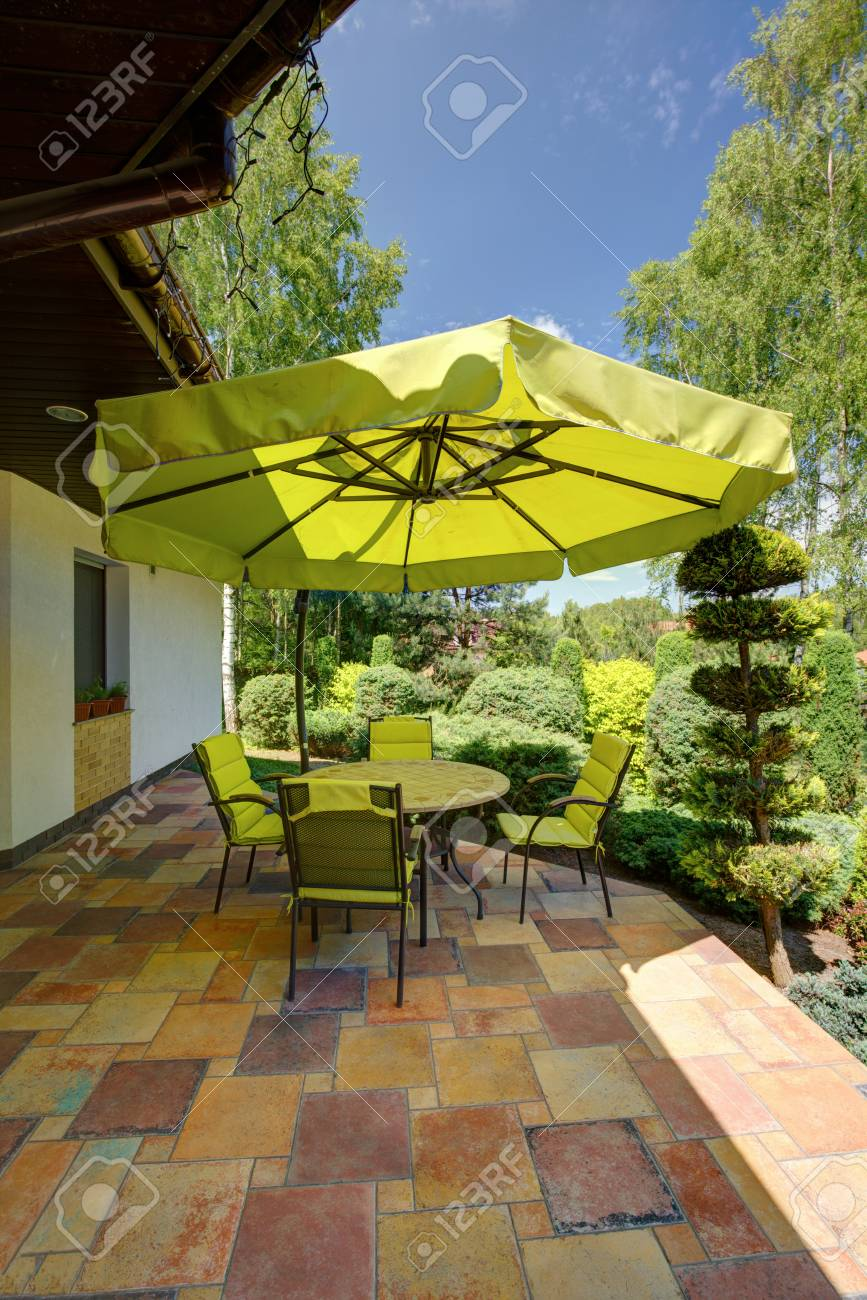 Image of green garden furniture with sunshade