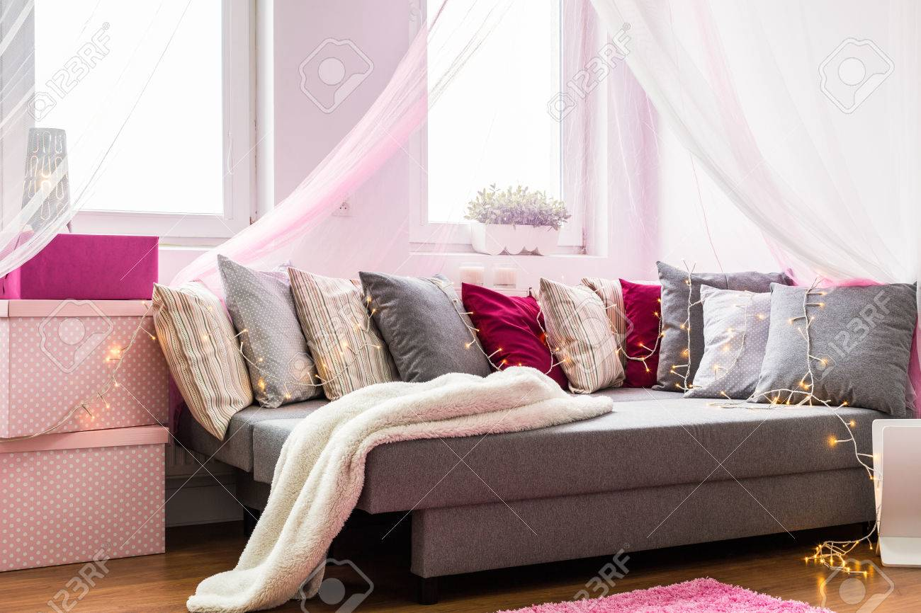 Comfortable Sofa With Colorful Pillows In Cute Bedroom Stock Photo Picture And Royalty Free Image Image 53515612