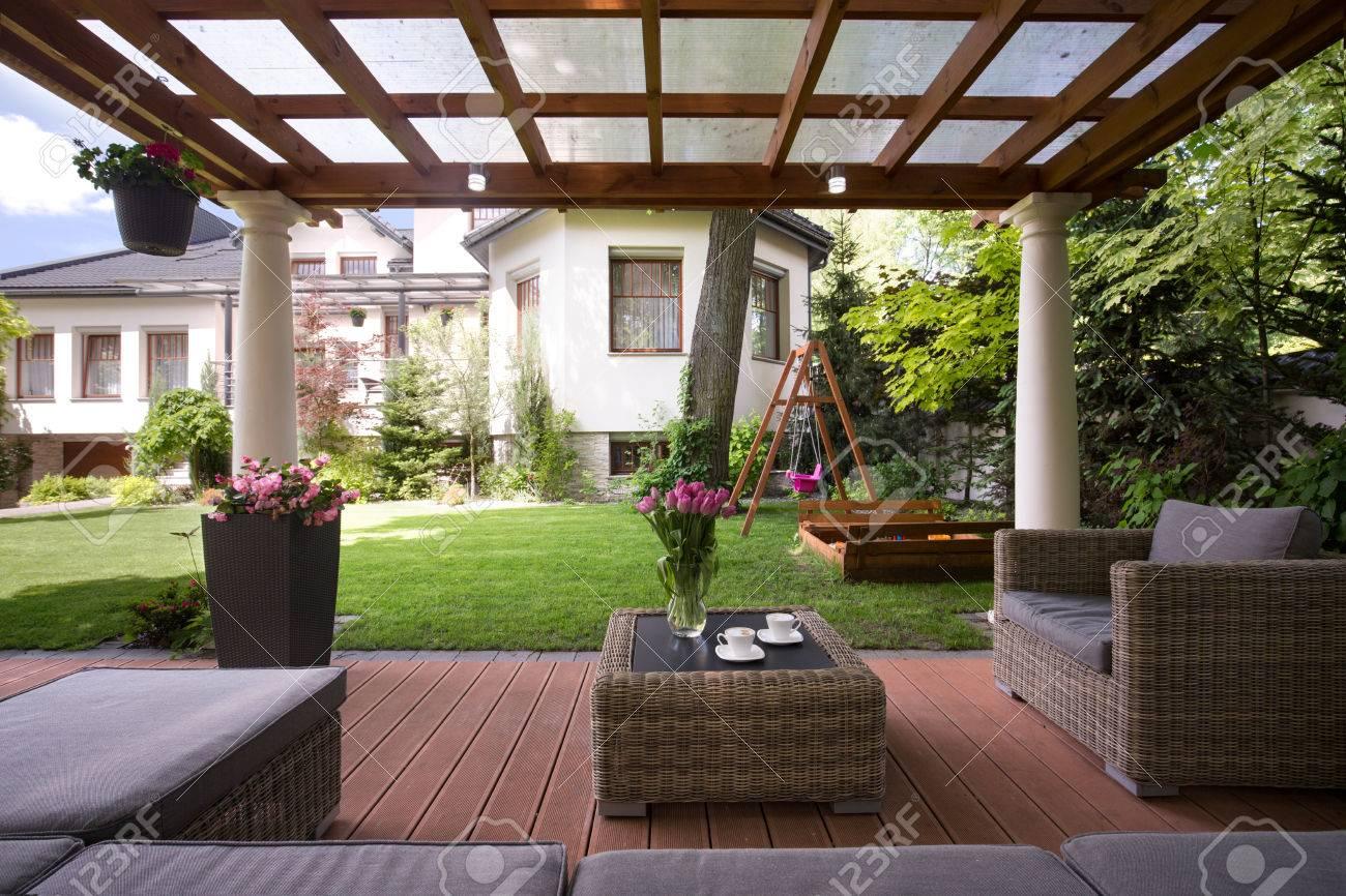 Close-up of gazebo with stylish garden furniture - 53989339