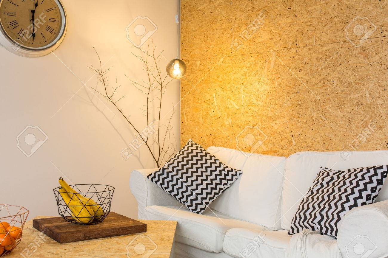 Warm Living Room With White, Linen Sofa And Chipboard Wall Stock ...