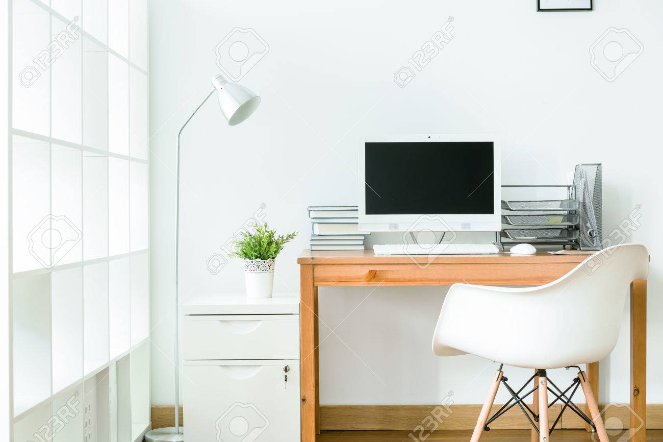 Study Room In White With Modern, Simple Furniture Stock Photo ...